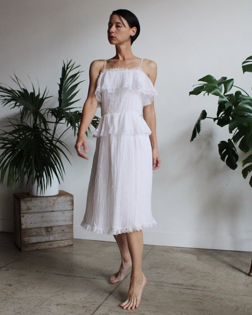 UNDER $50 - Romantic gauze for summer is always a good idea, and when its trimmed with lace and pearls for just $48, you really can't pass this up.