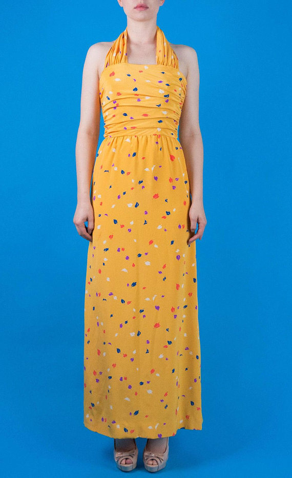 UNDER $500 - This had me at yellow silk halter, but being that It's Oscar de la Renta for just $258, i'm sold