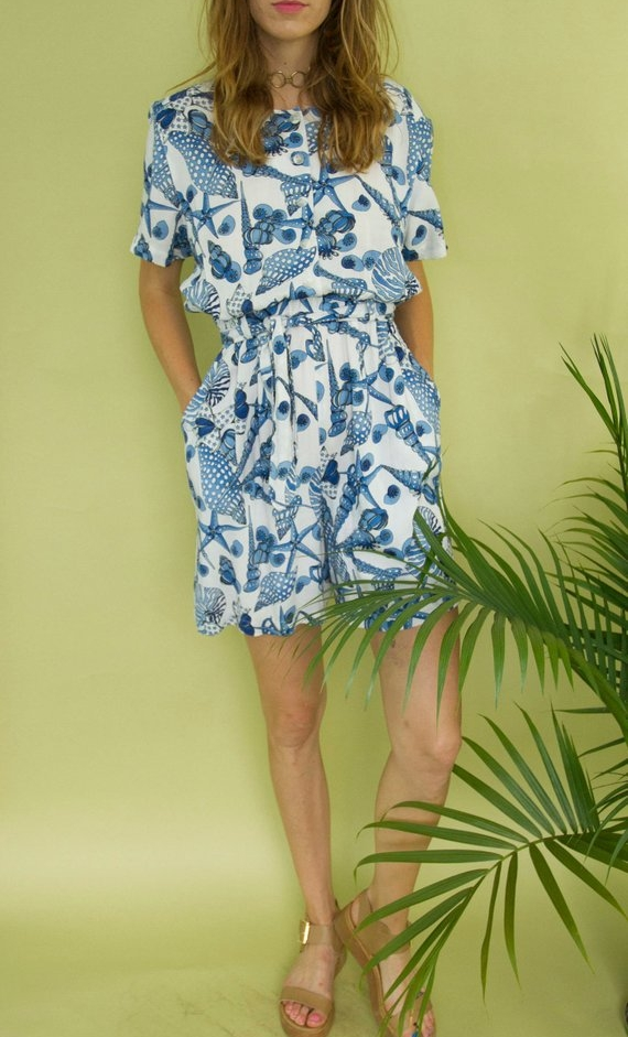 UNDER $50 - The cutest pleated shorts romper in a seashell print, with pockets.