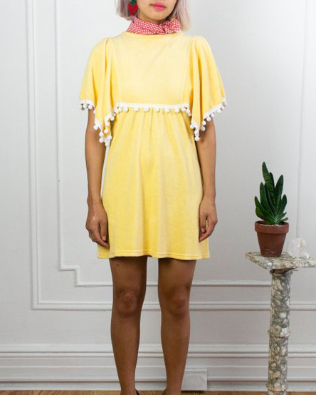 UNDER $200 - A little terry cloth for the poolside, and some pom poms for the party. Thissunny mini dress is perfect for a summer escape