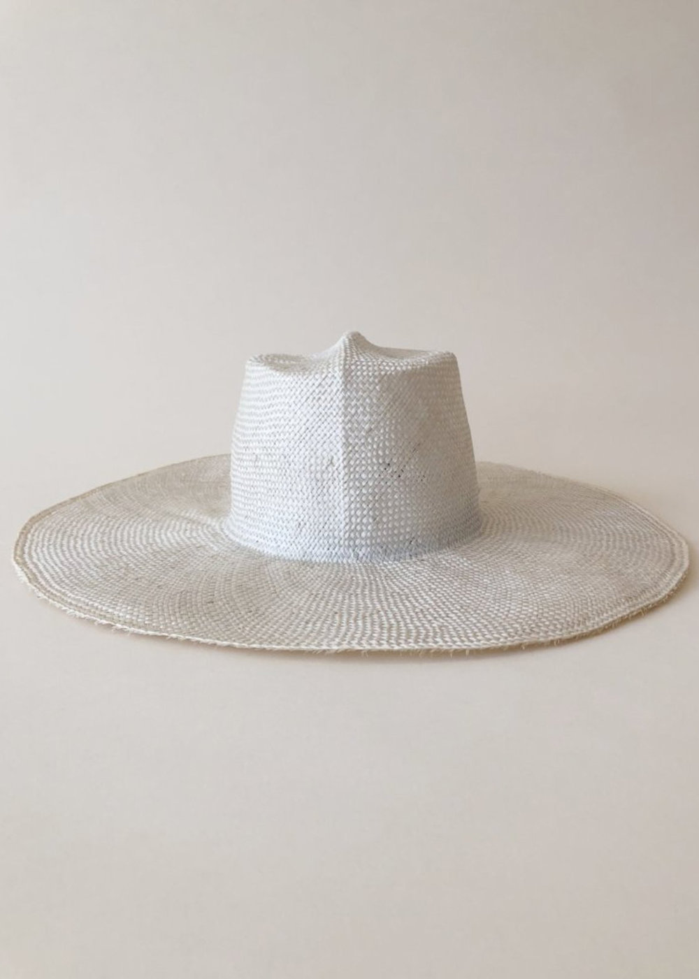 Wide brim straw hat - We are a fan of all Brookes Boswell hats, but we love the white color of this one to keep it light and the wide brim.