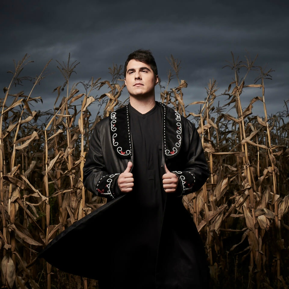 """Jeremy Dutcher - Jeremy Dutcher is a classically trained operatic tenor and composer who takes every opportunity to blend his Wolastoq First Nation roots into the music he creates, blending distinct musical aesthetics that shape-shift between classical, traditional, and pop to form something entirely new. Dutcher's debut release, Wolastoqiyik Lintuwakonawa, involves the rearrangement of early 1900s wax cylinder field recordings from his community. """"Many of the songs were lost because our musical tradition was suppressed by the Canadian government. I'm doing this work as there's only about a hundred Wolastoqey speakers left. It's crucial that we're using our language because, if you lose the language, you're losing an entire distinct way of experiencing the world."""""""