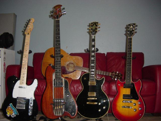 """Jack Rabbit Slim"" (late 80s Tele with hot rail pickups), ""Sasscrostch Plato-Pus"" (79/80 Ovation Magnum Bass), ""Wicked Lester"" (77 LP Custom), Yamahopper SG (76 Yamaha SG1500), and 73 Yamaha FG-240 Green label"