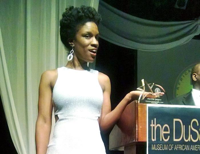 Charlette with award.jpg