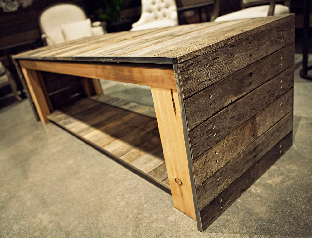 This coffee table was crafted from reclaimed palette's upcycled from DIRTT's local savannah plant and accented with metal edge banding for durability.