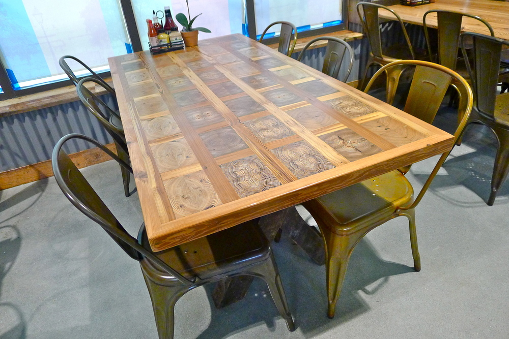 These dining tables consist of a custom pattern for WFM Savannah: bookmatched heart pine end cuts.