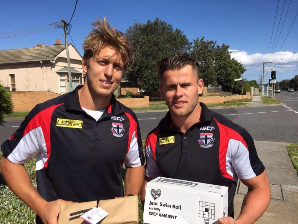 St Kilda players delighted members with a surprise visit and some delicious Jam Swiss Rolls!