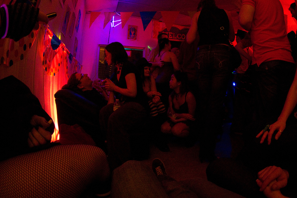 Partygoers relax in the chill area.