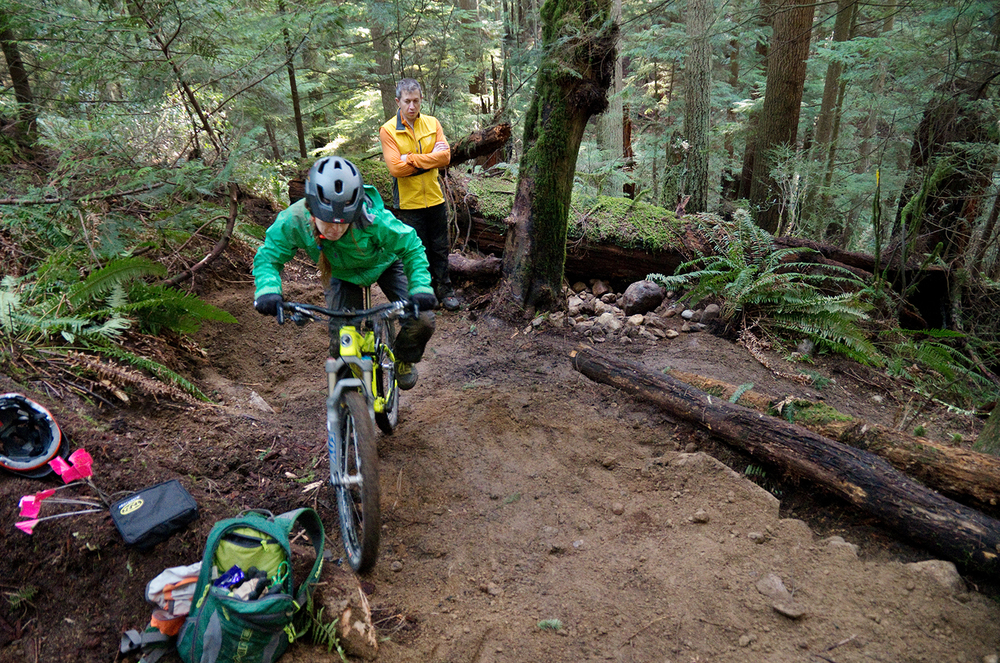 Martin and Penny would sometimes hike their bikes into the trail to test out new sections to make sure there were enough spots to rest and that the corners weren't too tight. The Infamous Corner 3 in particular was difficult to gauge, and was further refined after testing.