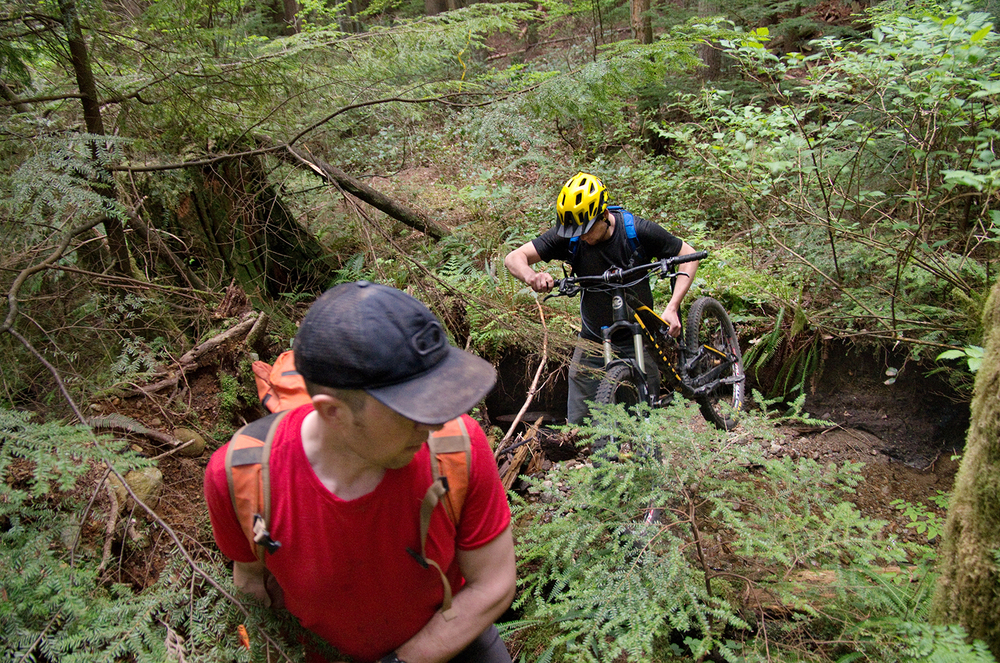 While the exit was in the middle of nowhere and the entrance was hidden to prevent inadvertent damage to the unfinished trail, the builders were careful to not be seen. They went in and out when no one was around, carried their bikes, and took many different routes to minimize damage to the surrounding forest.