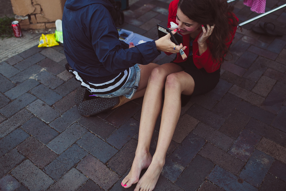 getting makeup done on the sidewalk in the suburbs of sydney.