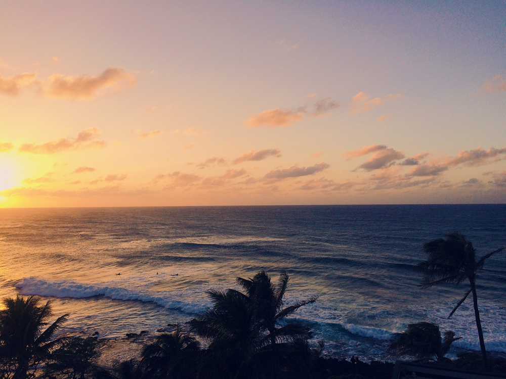 Watching the sun set over the ocean.