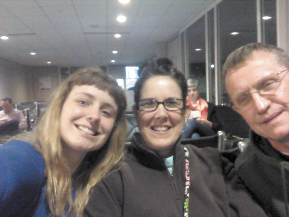 At the airport waiting for our plane, 5:30am so early!