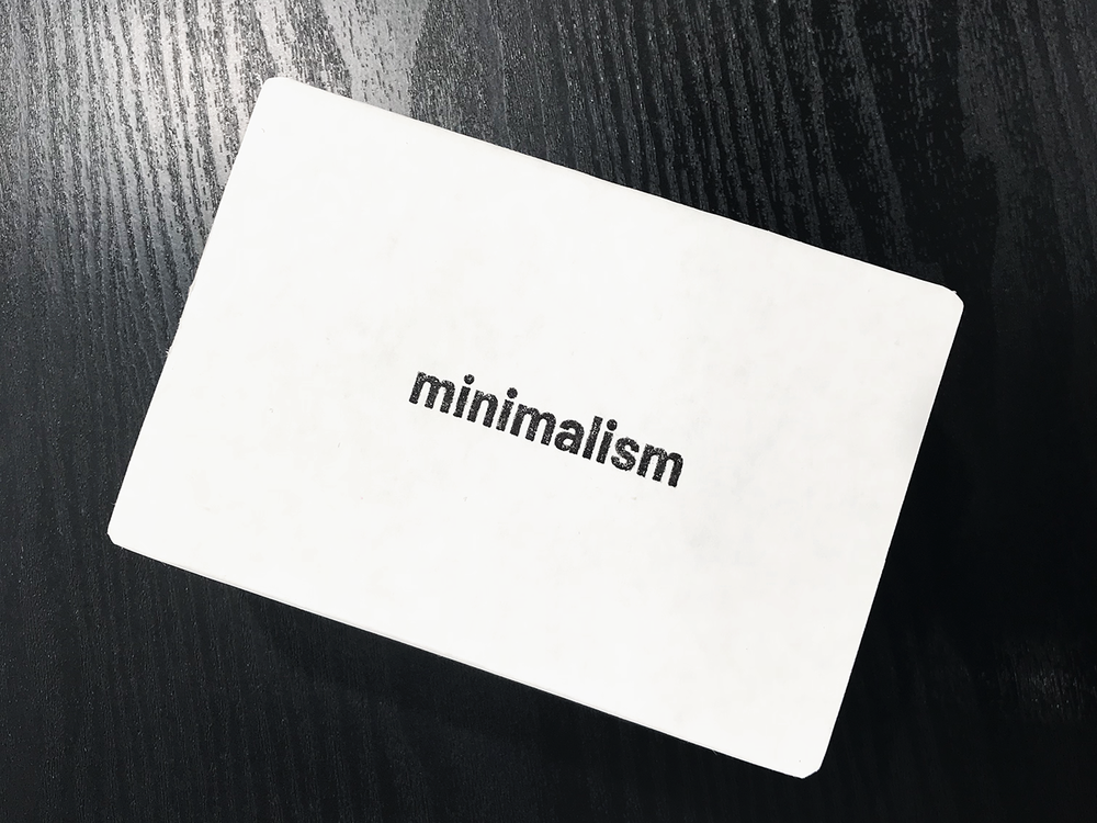 Minimalism:The GAme - Opportunity: Create a table-top game.Solution: A social, simple, and strategic card game about living with less.Idea:Getting rid of unnecessary stuff is a satisfying yet cumbersome task of life — let's gamify it.