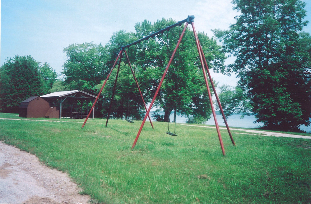 Swings at beach, Lake Simcoe, part of the grounds where children swam and played.