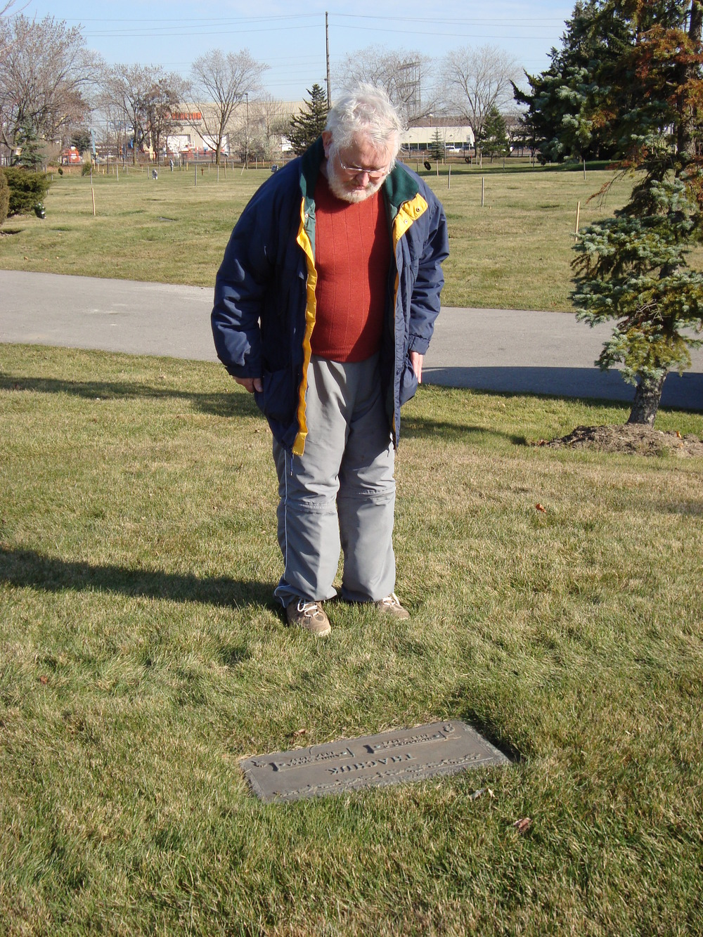 Barry at his grandparents' gravesite, 2010.