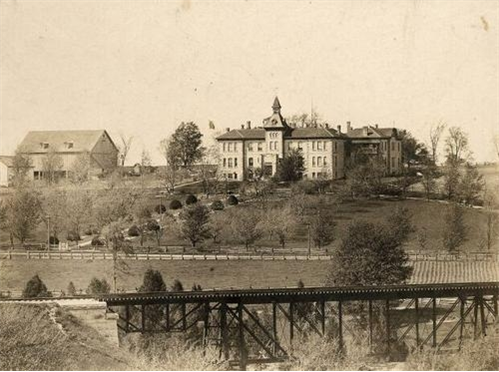 ph 10814: Wellington County House of Industry and Refuge, view from south side of the Grand River, ca. 1907-1914. Photographer unknown.