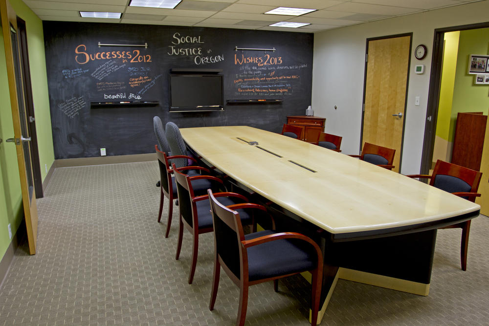 After: one of the main goals was to provide a dynamic gathering space for MRG to meet and discuss ideas.  Chalkboard paint and picture rails give the members plenty of space to interact, and share ideas, while also diminishing the presence of the TV.