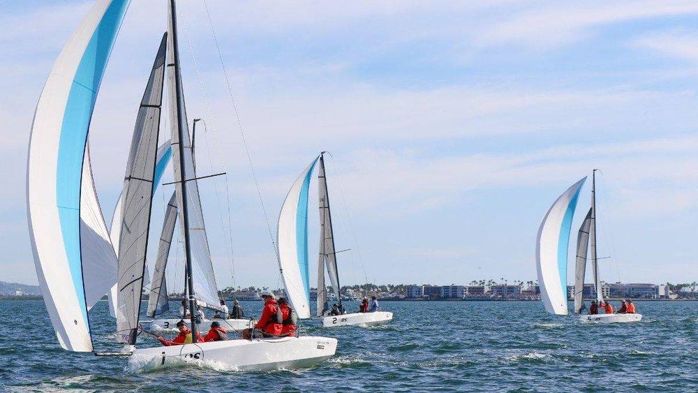 RS21 fleet sailing downwind.