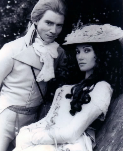 The Scarlet Pimpernel and Margo, in Black and White, against a tree, looking scandalous.