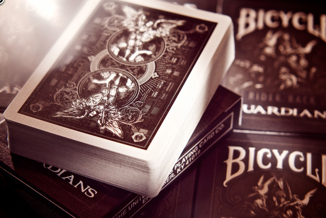 A black and white photo of the Bicycle Card Guardian's Deck, complete with amazing new black and white art featuring pretty badass angels. The cards I imagine would be used at The Fallen Angel