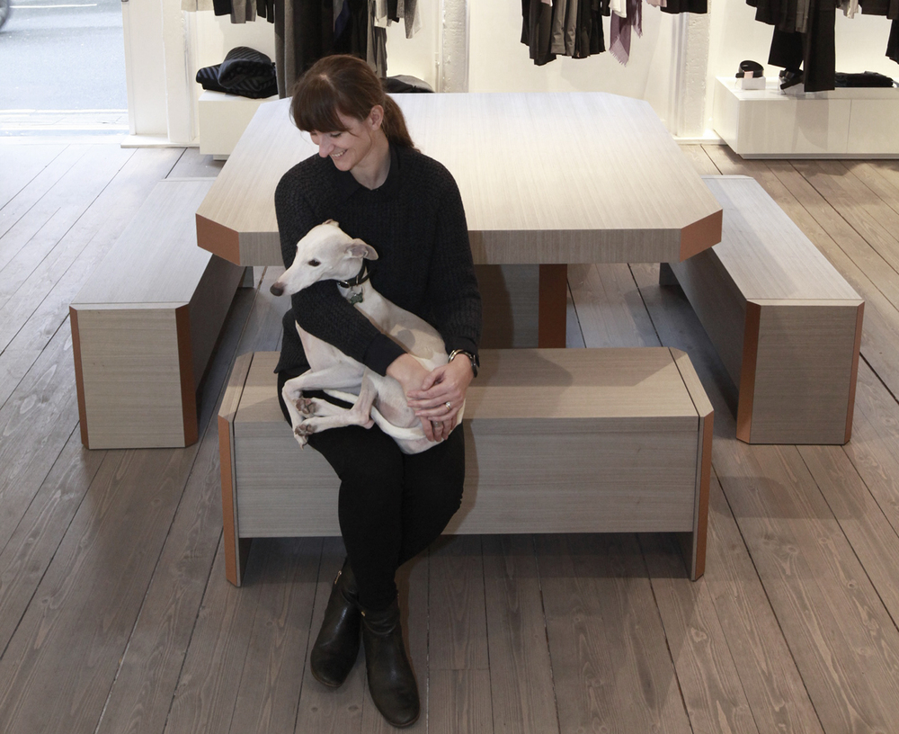 Corinna Warm at Kit and Ace's Borough Market store with Otto the white whippet, perfectly matching the interior.