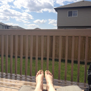 Sunshine in the backyard on a deck on a long weekend
