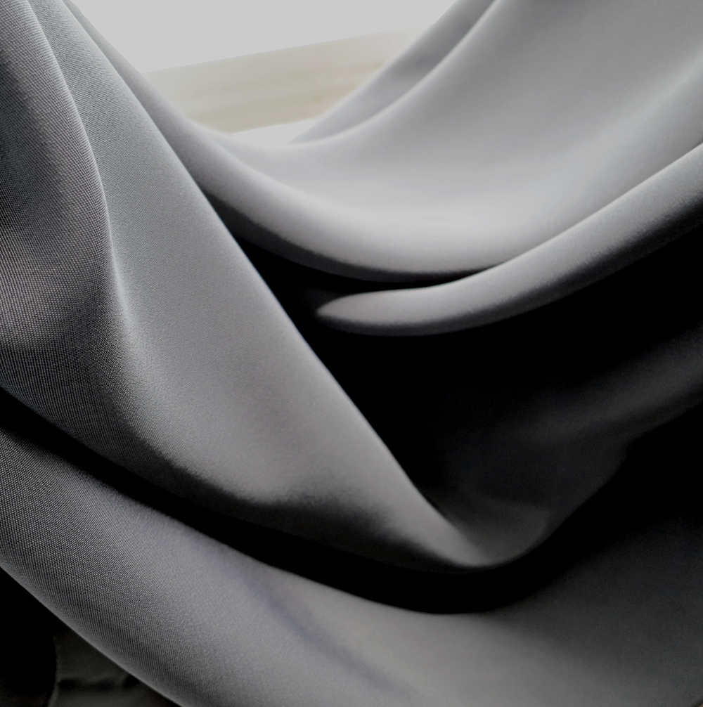- Italian Viscose - Textured Drape - Our Italian Viscose possesses a slinky drape and subtle shine. A soft fabric with a slightly textured weave, the Italian Viscose wicks away moisture and works beautifully with free-flowing silhouettes.