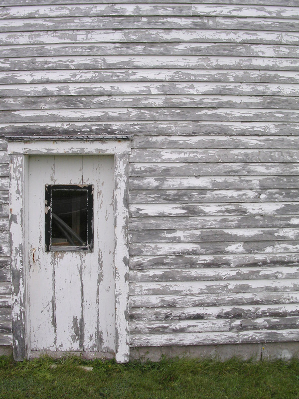 Clap board shed on a roadside in the Bay of Fundy