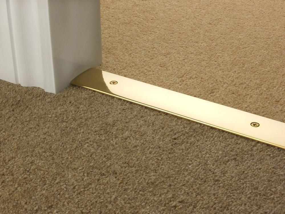 Door_bar_brass_cover_carpet_carpet