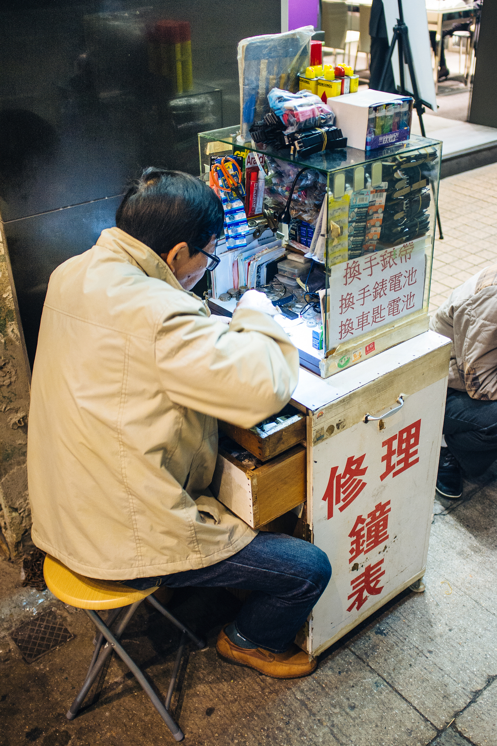 Mong Kok is lousy with these tiny watch repairmen.