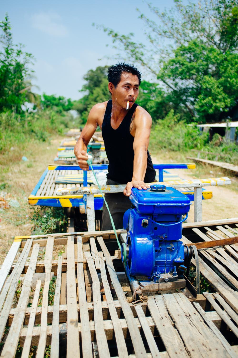 Cambodian Bamboo Rail Driver.jpg