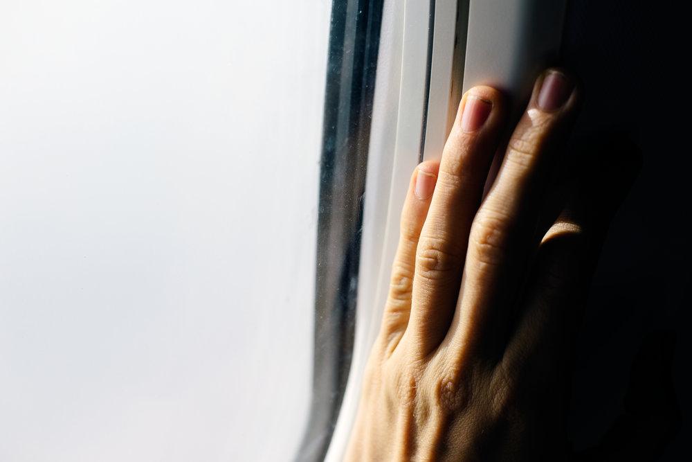 Plane Window Hand.jpg