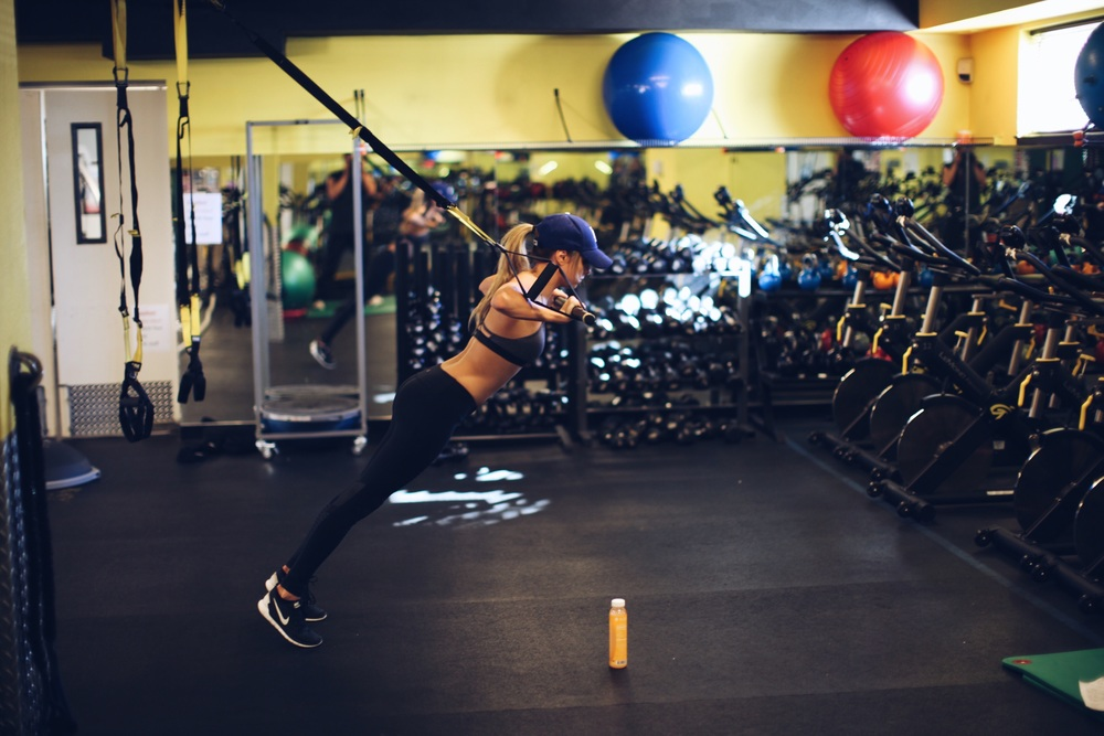 Slide a broom or any kind of bar through your TRX handles for push-ups. These will sneak up on you so take it slow.. Make sure to keep the hands wide. The bar is unstable so these really make you use your arms and core to stabilize.