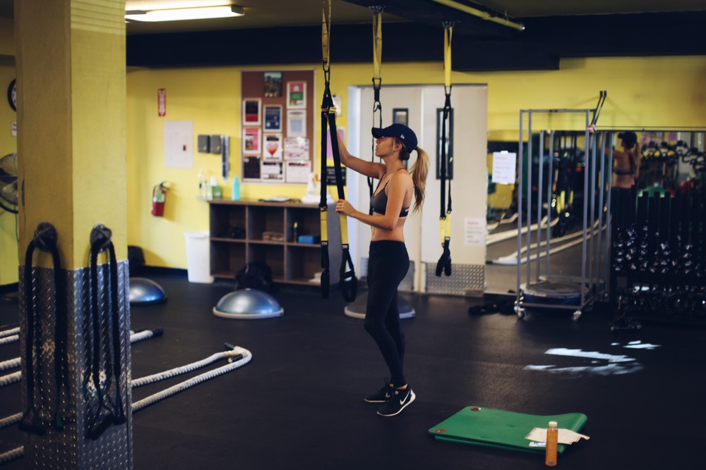 Slide your TRX bands down to the lowest point.
