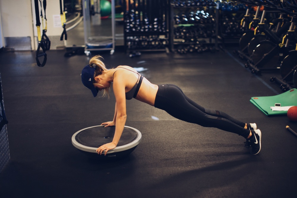 The bosu ball should be your new best friend in the gym. You can make any easy exercises more challenging by adding it in.