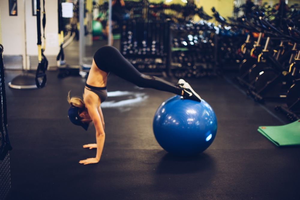 Roll up and pull glutes to ceiling. Make sure to keep abs activated through entire movement.