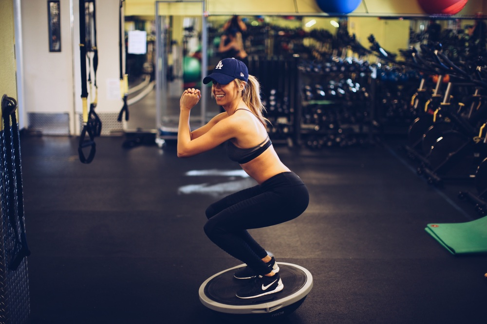 Again, the bosu ball just makes your average squat that much more challenging and effective by forcing you to use that core to balance.