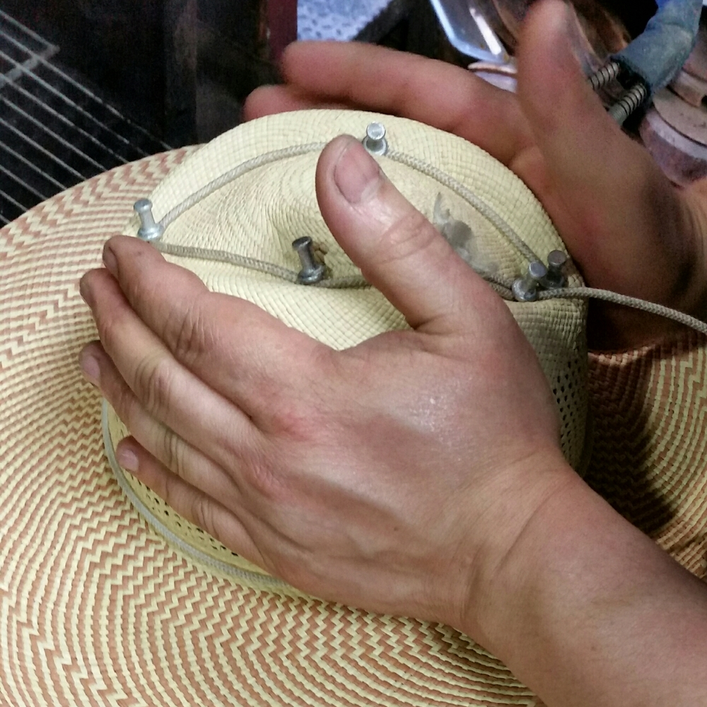 Hand crafted means made by hand ! All the hats are formed on wooden blocks by hand , not mechanically .
