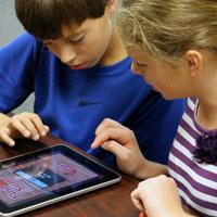 Students utilizing iPad technology.