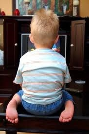 sharron kid watching tv