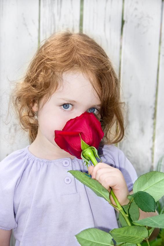 girl smelling rose.jpg