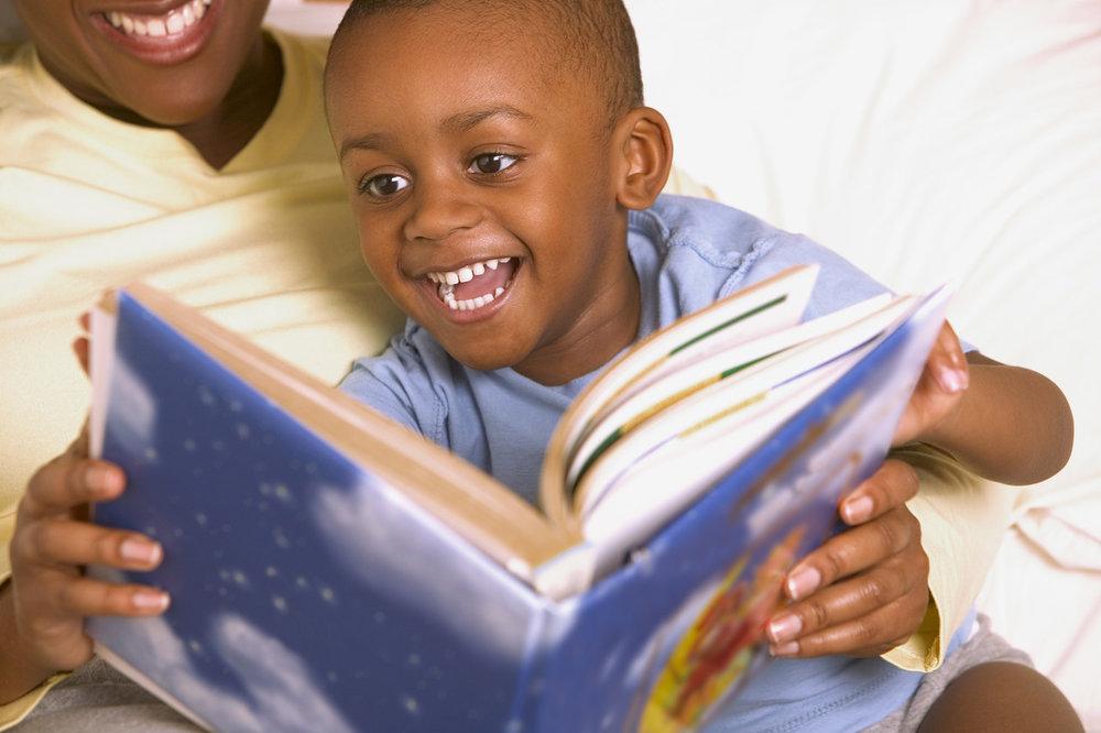 boy reading blue shirt.jpg