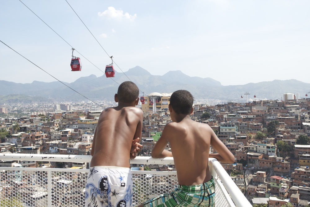 Two boys chat as they look out over the Complexo do Alemão. Photo: Flora Charner