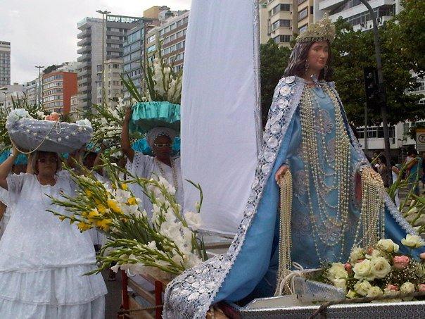Worshippers carry offerings for Iemanja in Copacabana, Rio de Janeiro