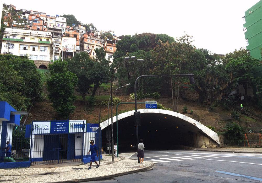 Sá Freire Alvim tunnel at the corner of Sá Ferreira and Raul Pompeia in Copacabana. Pavão-Pavãozinho favela in upper left corner