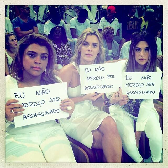 Celebrities Preta Gil, Carolina Dieckmann and Fernanda Paes Leme hold up sign (Posted to Facebook by Preta Gil - 04/28/14)