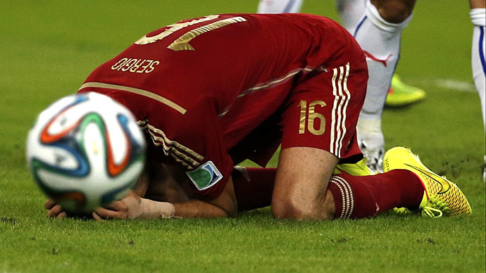 Spain's Sergio Busquets on the floor after missing decisive goal opportunity (Photo by Jorge Silva/Reuters)