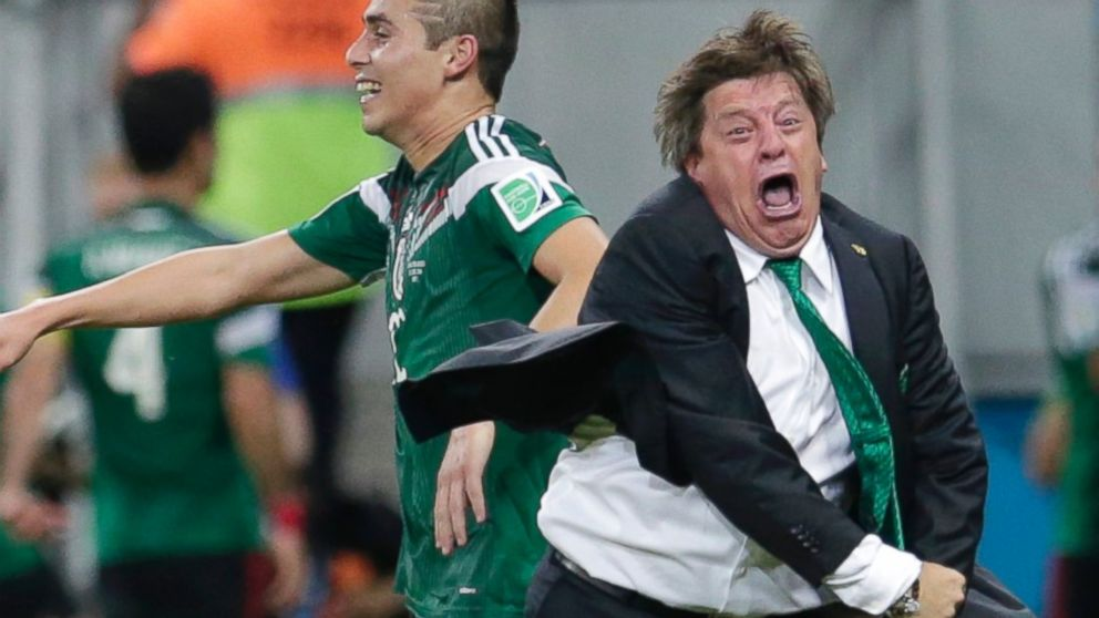 "Mexico coach Miguel ""El Piojo"" Herrera celebrates goal on sidelines (Photo by Petr David Josek/AP)"