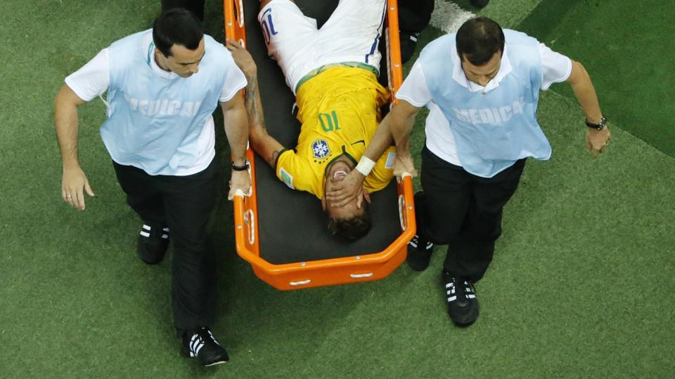 Brazil's Neymar grimaces as he is carried off the pitch after being injured during the July 4th 2014 World Cup quarter-finals against Colombia at the Castelao arena in Fortaleza (SOURCE: Reuters).